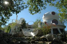 """The Unal House. – Designed by Claude Häusermann-Costy and built by Joël Unal, the Unal house is a bubble house without a single right angle. The house is part of an movement known as """"sculpted architecture""""."""