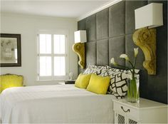 battery-operated sconces on padded headboard