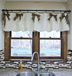 White and Gold Kitchen Window Valances. We weren't sure if we could create kitchen window valances for under $20 but we did and we loved every minute of it! DIY Valances - for under $20 from Hobby Lobby (using coupons of course). Making your own valances is easy, don't spend a fortune on home decor!
