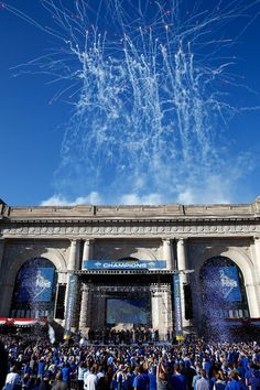 Fireworks explode over Union Station as Kansas City Royals players hold a rally and celebration following a parade in honor of thier World Series win on November 3, 2015 in Kansas City, Missouri.