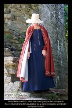 Look at how the cloak is embellished. The white running treatment on the gown slit is cool as well.