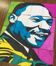 Black History Month collaborative portrait poster art lesson. Students work in groups of 3 as a team to create designs for Black History Month at Collins Middle School in Corsicana Texas. Each Black History Month design is made up of 16 small squares to create this art. Martin Luther King Jr. Artwork. This is also a great Art Project for MLK Day.
