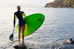 Rosy Hodge wearing the High Seas wetsuit with her SUP #ROXYOutdoorFitness
