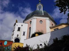 The Number 6 festival takes place in Portmeirion, Wales every September - live music, torch-lit processions, DJs and luxurious camping and toilets!