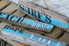 Selection of driftwood signs