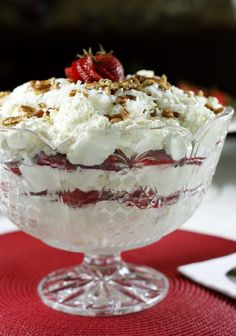 Classic Southern Strawberry-Coconut Punch Bowl Cake ... crowd-pleasing creamy layers of angel food cake, whipped cream, fresh strawberries, & coconut.   www.thekitchenismyplayground.com