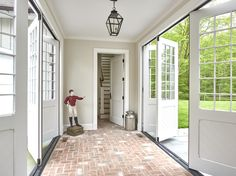 Breezeway with folding doors and brick floor Outdoor Room Colonial Shingle Style Farmhouse by Huestis Tucker Architects, LLC Best Flooring, Brick Flooring, Floors, Home Renovation, Home Remodeling, Breezeway, Folding Doors, Home Additions, Outdoor Rooms