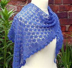 Free on Ravelry. This lightweight lace shawl is an unusual arrow head shape allowing it to sit well over the shoulders and back.
