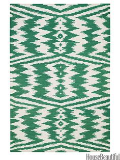 A graphic green ikat rug from capelrugs.com. housebeautiful.com. #green #graphic_rugs #rugs #ikat