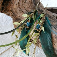 MERMAID TAILS Fantasy Feather, Chain and Crystal Bead Mermaid Earrings. $40.00, via Etsy.