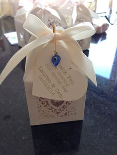 Home made Turkish-English wedding favours, containing Turkish delight and English fudge + an evil eye pin