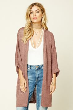 - A ribbed knit cardigan featuring a drapey open front and 3/4 sleeves.