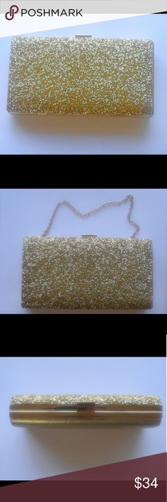 Gold Confetti Solid Clutch Purse | Evening Bag A petite gold solid clutch. The front is encrusted with beautiful sparkling gold crystals and the back is a lovely satin fabric. The inside is lined with gold fabric as well.  Wear with or without the jewelery-style strap. Clasp and hinge construction. This formal bag is petite enough to carry but has ample space inside for your necessities.  Only used once! Macy's Bags Clutches & Wristlets