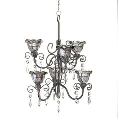 """Midnight Blooms Tiered Chandelier. The bewitching glow of twilight can decorate your room night after night with this gorgeous candle chandelier. Two tiers of smoky glass candle cups sit upon a mesmerizing black metal scrollwork frame.  Item weight: 2.80lbsItem dimensions: 11.25"""" W x 12.88"""" H x 10.00"""" LMaterials: Metal, GlassUPC: 849179018474"""