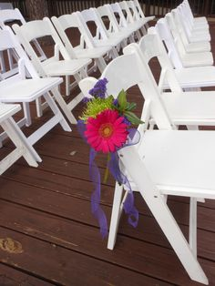 wedding flowers. pew decor. ceremony decor. hot pink gerber daisy, green spider mum, purple statice. purple ribbon. The Woodlands Resort and Conference Center. http://thebloomingidea.blogspot.com