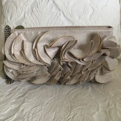 White House/ Black Market clutch Cute Champagne colored sparkly clutch with fun ruffle detail and silver hardware by White House/ Black Market (great condition with some small black marks on inside lining) White House Black Market Bags Clutches & Wristlets