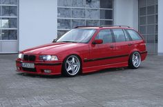 Hellrot BMW e36 touring on OEM BMW Styling 40 (Z3 M) wheels