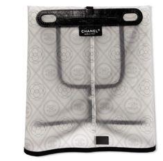 6ab56dd5325c19 A white & black pvc, grosgrain & calfskin leather handbag raincoat with  silver hardware
