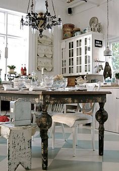 Obsessed with this kitchen: from the tiles on the floor to the antique table to the fabulous chandelier