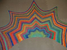 This is an easy crochet wrap worked in a simple ripple. Shaping includes extra coverage for front wrapping. Once the pattern is established, it can be crocheted to any size.