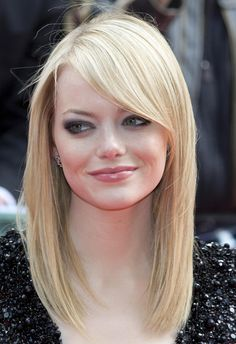 Emma Stone simple side swept bangs and mid/long hair