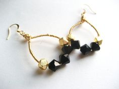 Classy, elegant, and a little bit edgy earrings - These are all you need to spike up your outfit for a day or night on the town! Black Glass Crystal with Gold Nugget Danglies by Joveda on Etsy