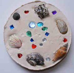 Garden Plaque craft using pie tin, Plaster of Paris, and treasures to press in.