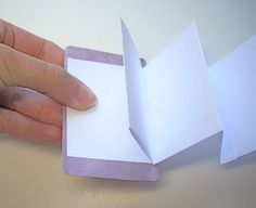 cardbook13 by CraftyPod. How to make simple accordian books with playing card covers.