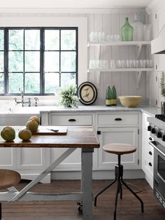 White finished cabinets are so versatile--they can be very casual and farmhouse-like...
