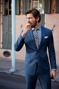 Navy suit + red and blue checkered tie + pocket square