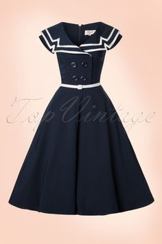 This50s Captain Flare Dress is a real must-have for the Sailor girls among us!  This Sailor swing beauty features faux double breastedbuttons and a wide over the shoulder collar that forms a beautiful contrast with the waist, making it look real petite ;-) The collar is finished off with white satin trims for a nautical touch. Made from a firm yet supple fabric with a light stretch in a typical navy blue colour and finished off with a white fabric belt. Ladies don't le...