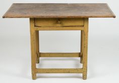 NEW ENGLAND PAINTED PINE ONE-DRAWER TAVERN TABLE, single-board scrubbed top with wide overhang and bread-board ends, above a single drawer r...