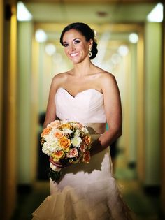 I loved how this bouquet complimented her gown without over shadowing it. http://www.perfectweddingflowers.com