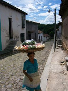 Suchitoto - Away from the city in a smaller town a women selling things.