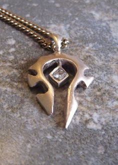 Bronze World of Warcraft Horde Necklace. $40.00, via Etsy.