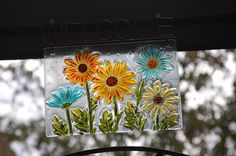 Pretty stained glass piece welcoming guests to the back garden.