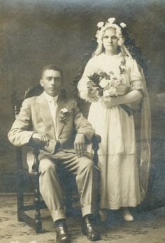 Antique wedding photo. Shes wearing real flowers in her hair and is wearing a garland of flowers I've been in many late 19th and early 20th century wedding photos from areas in the MidWest US that had many Scandinavian immigrants.