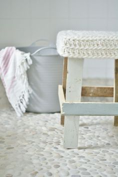 homemade wood stool with knit cover and beach stone flooring - White pebble tile… Slate Flooring, Vinyl Flooring, Penny Flooring, Ceramic Flooring, Garage Flooring, Farmhouse Flooring, Linoleum Flooring, Flooring Ideas, Bathrooms
