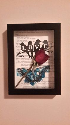 Shadow box with a dried rose. Pictures were printed on book pages.