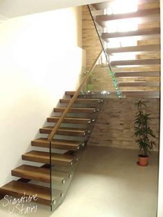 These floating stairs are built using a metal structure that's installed at the early stage of the build-project - the structure is then hidden by stone cladding or plasterboard before the steps are clad & the glass balustrade is fitted - superb way of in Entryway Stairs, Rustic Stairs, Modern Stairs, Basement Stairs, Interior Stair Railing, Stair Handrail, Staircase Design, Timber Handrail, Stair Design