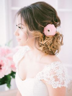 ombre wedding updo hairstyle with pink flower / http://www.deerpearlflowers.com/25-romantic-long-wedding-hairstyles-using-flowers/
