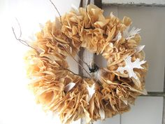 I love this, minus the branch and bird. Its coffee filters dyed with coffee (free supplies = work) and leaf cutouts from a book for that fall romantic feel. Im considering doing wreaths on every other pew - istead of the flower pomanders... thoughts MOH @Charle Smith and Bridesmaid @Kristi G.