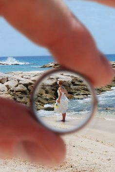 Capture a photo of the bride through the groom's wedding ring