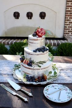 Semi naked wedding cake with silver leaf accents and fall fruits by Sablée!
