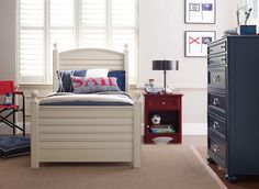 Red, white and blue create a sparkling, crisp nautical room.
