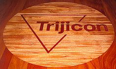 Intricate inlaid corporate logo, custom designed by Specialty Woods. Aiming High Trijicon. American handmade. 509-466-4684