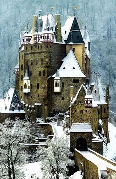 Eltz Castle, a medieval castle located on a hill in the forest in winter, Germany