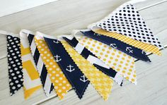 Yellow and Navy Blue Stripes, Chevron and Anchors make up this adorable Nautical Fabric Bunting! ~ The 11 flag Bunting Banner measures 6 feet long