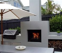 modern outdoor fireplace incorporated into an outdoor kitchen area Contemporary Outdoor Fireplaces, Rustic Outdoor Fireplaces, Outdoor Fireplace Designs, Fireplace Modern, Fireplace Ideas, Fireplace Seating, Fireplace Hearth, Outside Fireplace, Backyard Fireplace