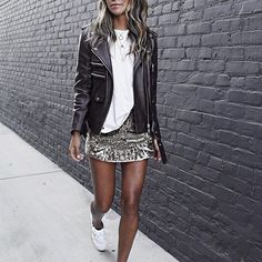 Shine on in a sparkly mini skirt paired with a leather moto jacket and an oversized t-shirt. We are loving this look from Sincerely Jules.